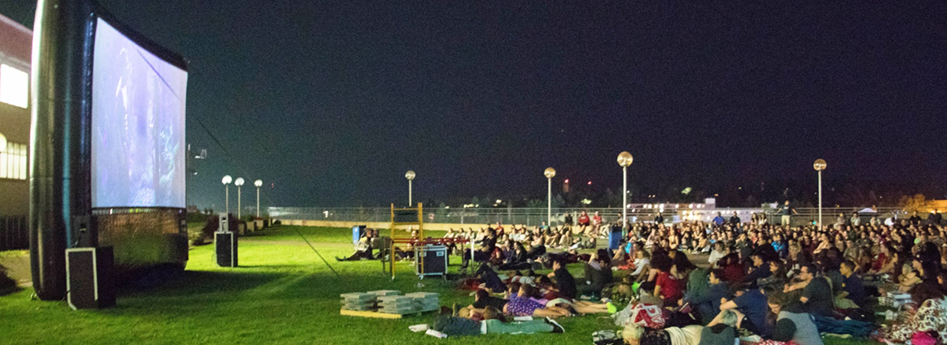 Students watch a movie outdoors on the Terrell Library rooftop
